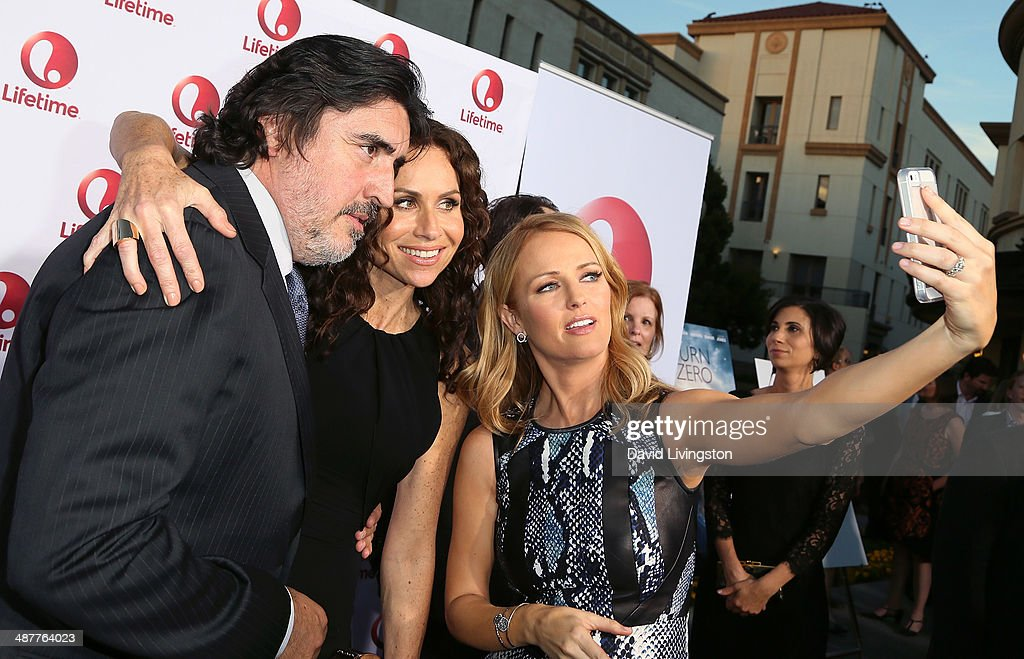 Actors <a gi-track='captionPersonalityLinkClicked' href=/galleries/search?phrase=Alfred+Molina&family=editorial&specificpeople=211218 ng-click='$event.stopPropagation()'>Alfred Molina</a> and <a gi-track='captionPersonalityLinkClicked' href=/galleries/search?phrase=Minnie+Driver&family=editorial&specificpeople=201884 ng-click='$event.stopPropagation()'>Minnie Driver</a> and Entertainment Tonight correspondent Brooke Anderson pose for a selfie at the premiere of Lifetime Television's 'Return to Zero' at the Paramount Theater on the Paramount Studios lot on May 1, 2014 in Hollywood, California.