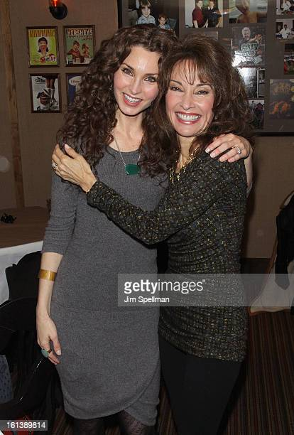 Actors Alicia Minshew and Susan Lucci attend the 'Spontaneous Construction' premiere at Guys American Kitchen Bar on February 10 2013 in New York City