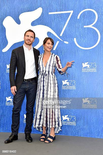 Actors Alicia Vikander and Michael Fassbender attend a photocall for 'The Light Between Oceans' during the 73rd Venice Film Festival at on September...