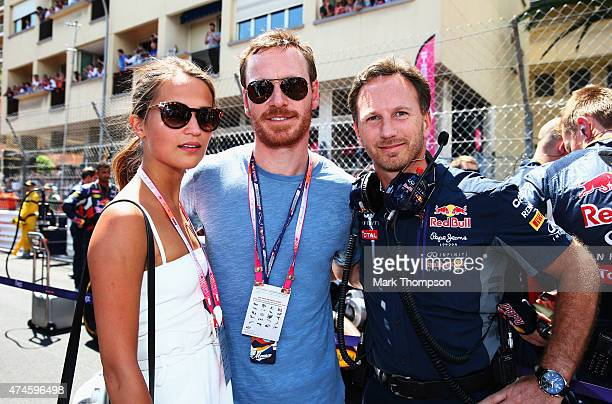 Actors Alicia Vikander and Michael Fassbender talk with Infiniti Red Bull Racing Team Principal Christian Horner before the Monaco Formula One Grand...