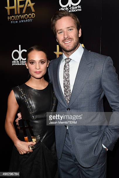 Actors Alicia Vikander winner of the Hollywood Breakout Actress Award for 'The Danish Girl' and Armie Hammer pose in the press room during the 19th...