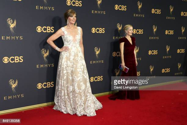 Actors Allison Janney and Gillian Anderson attend the 69th Annual Primetime Emmy Awards Arrivals at Microsoft Theater on September 17 2017 in Los...