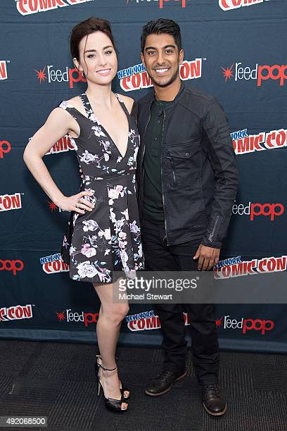 Actors Allison Scagliotti and Ritesh Rajan pose in the press room for the 'Stitchers' panel during New York ComicCon Day 2 at The Jacob K Javits...