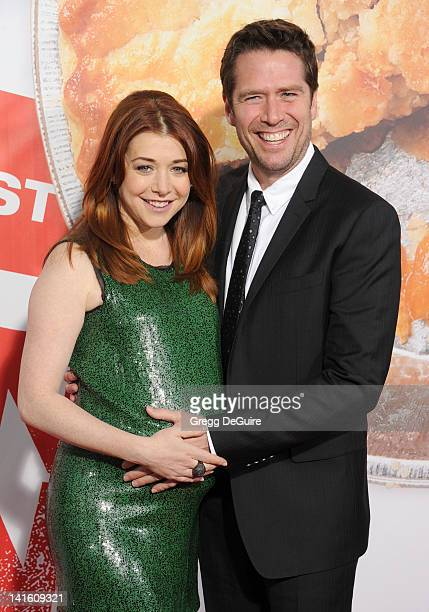 Actors Alyson Hannigan and Alexis Denisof arrive at 'American Reunion' Los Angeles Premiere at Grauman's Chinese Theatre on March 19 2012 in...