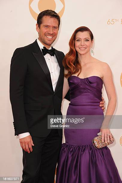 Actors Alyson Hannigan and Alexis Denisof arrive at the 65th Annual Primetime Emmy Awards held at Nokia Theatre LA Live on September 22 2013 in Los...