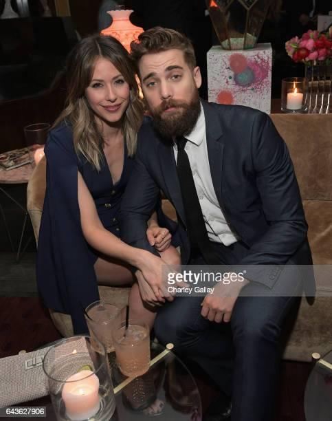Actors Amanda Crew and Dustin Milligan attend Vanity Fair and L'Oreal Paris Toast to Young Hollywood hosted by Dakota Johnson and Krista Smith at...