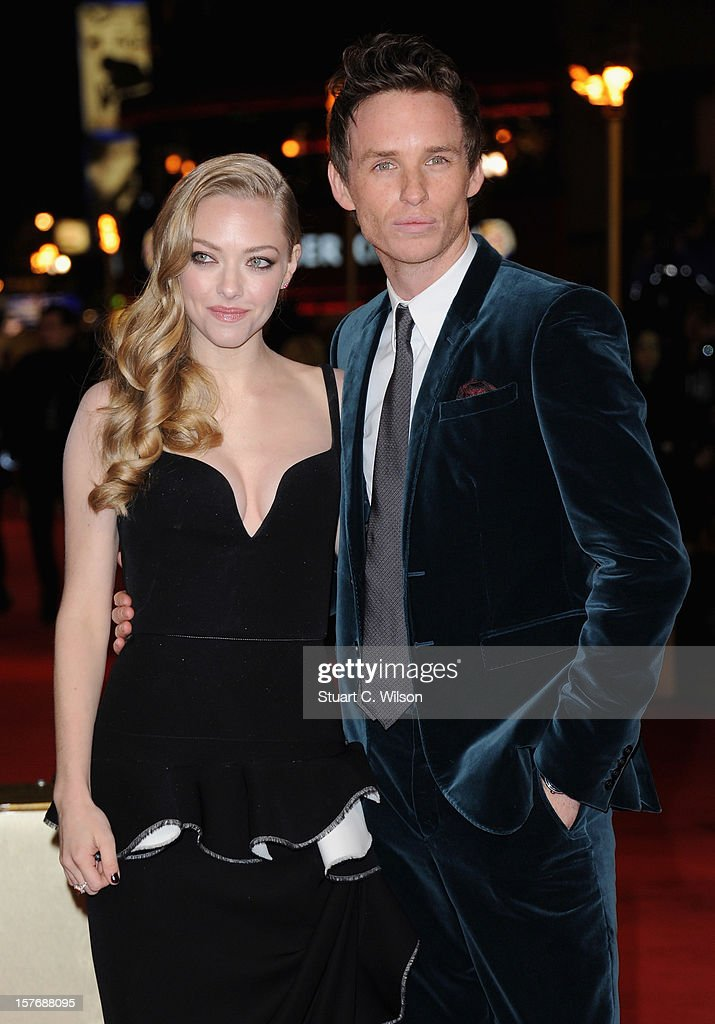 Actors Amanda Seyfried and Eddie Redmayne attend the 'Les Miserables' World Premiere at the Odeon Leicester Square on December 5, 2012 in London, England.
