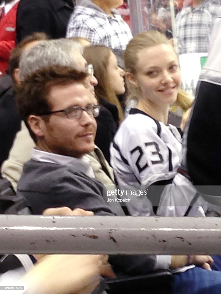 Actors Amanda Seyfried and Kevin Connolly attend theVancouver Canucks vs. Los Angeles Kings game at the Staples Center on January 28, 2013 in Los Angeles, California.