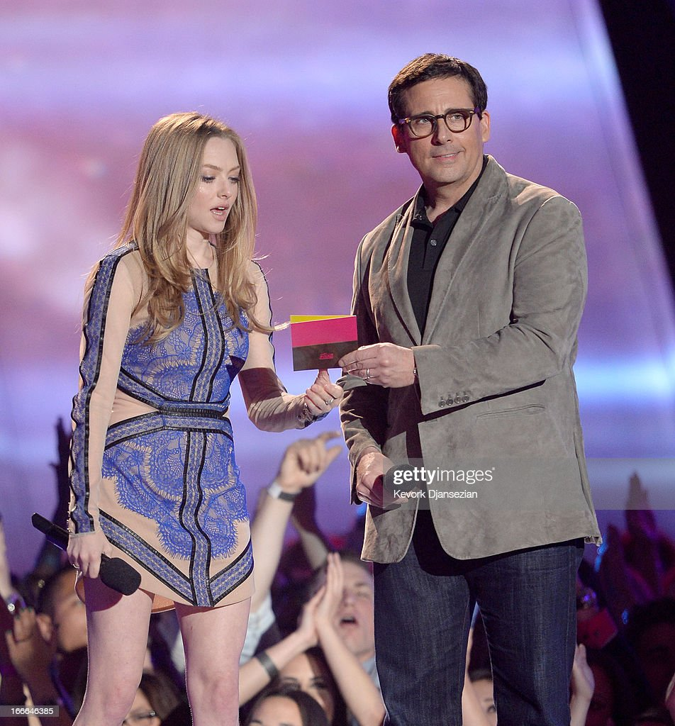 Actors Amanda Seyfried and Steve Carell speak onstage during the 2013 MTV Movie Awards at Sony Pictures Studios on April 14, 2013 in Culver City, California.