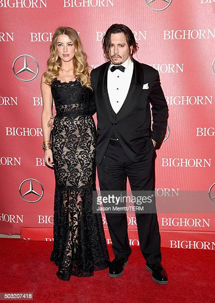 Actors Amber Heard and Johnny Depp attend the 27th Annual Palm Springs International Film Festival Awards Gala at Palm Springs Convention Center on...