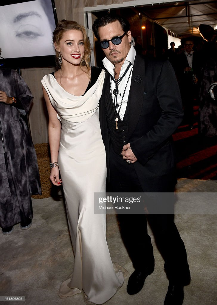 Actors Amber Heard and Johnny Depp attend the 8th Annual HEAVEN Gala presented by Art of Elysium and Samsung Galaxy at Hangar 8 on January 10 2015 in...