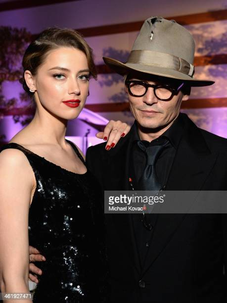 Actors Amber Heard and Johnny Depp attend The Art of Elysium's 7th Annual HEAVEN Gala presented by MercedesBenz at Skirball Cultural Center on...