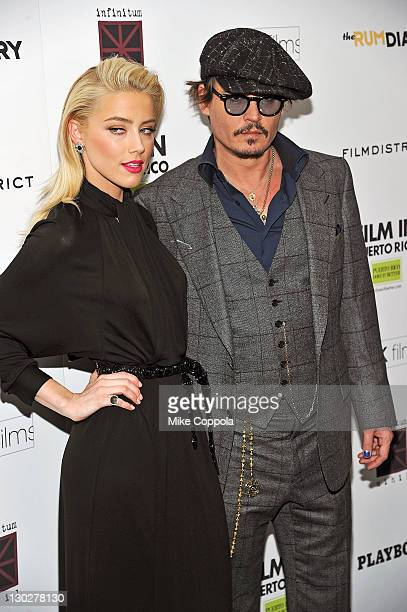 Actors Amber Heard and Johnny Depp attend the 'The Rum Diary' New York premiere at the Museum of Modern Art on October 25 2011 in New York City