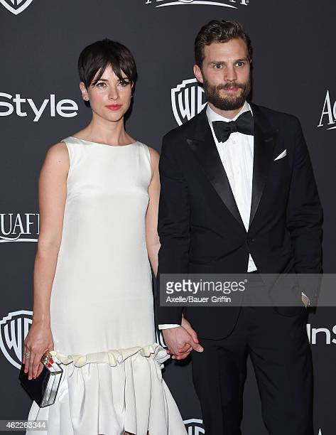Actors Amelia Warner and Jamie Dornan arrive at the 16th Annual InStyle and Warner Bros Golden Globe AfterParty at The Beverly Hilton Hotel on...