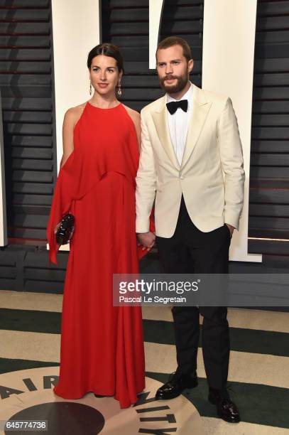 Actors Amelia Warner and Jamie Dornan attend the 2017 Vanity Fair Oscar Party hosted by Graydon Carter at Wallis Annenberg Center for the Performing...