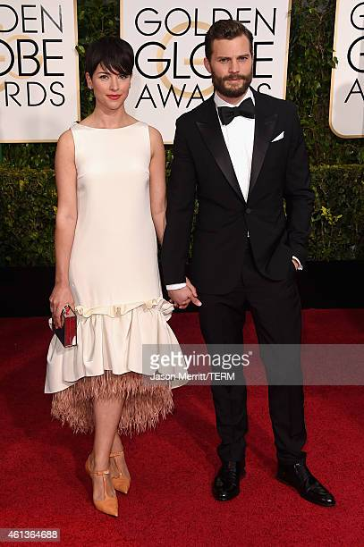 Actors Amelia Warner and Jamie Dornan attend the 72nd Annual Golden Globe Awards at The Beverly Hilton Hotel on January 11 2015 in Beverly Hills...
