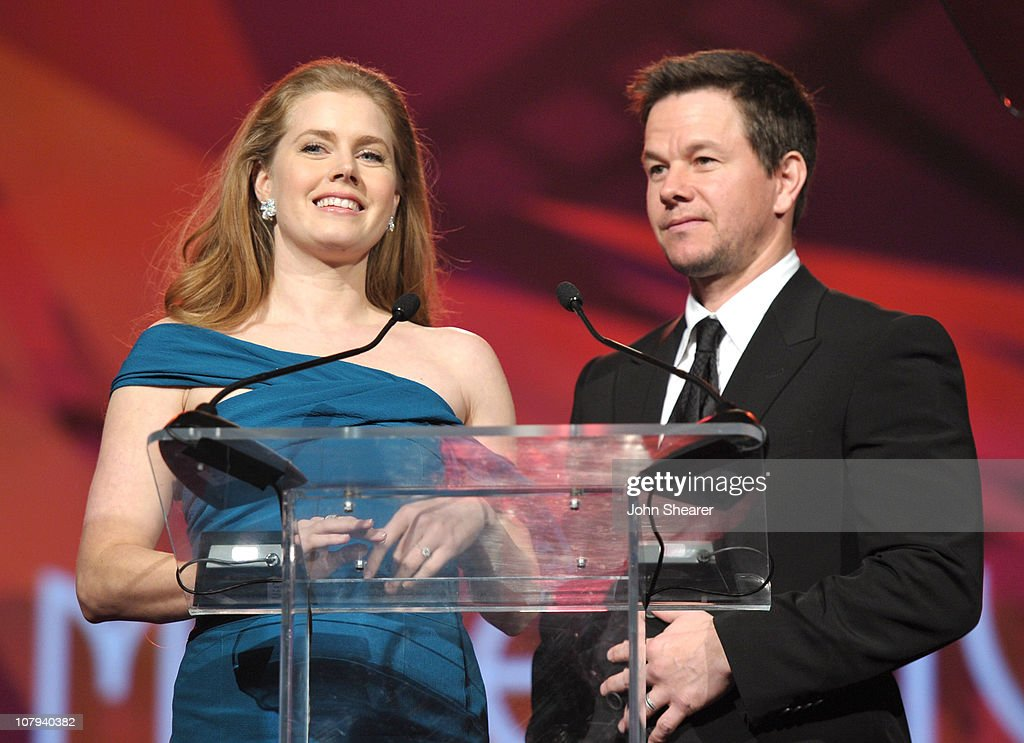 Actors <a gi-track='captionPersonalityLinkClicked' href=/galleries/search?phrase=Amy+Adams&family=editorial&specificpeople=213938 ng-click='$event.stopPropagation()'>Amy Adams</a> and <a gi-track='captionPersonalityLinkClicked' href=/galleries/search?phrase=Mark+Wahlberg&family=editorial&specificpeople=202265 ng-click='$event.stopPropagation()'>Mark Wahlberg</a> speak onstage during the 22nd Annual Palm Springs International Film Festival Awards Gala at the Palm Springs Convention Center on January 8, 2011 in Palm Springs, California.