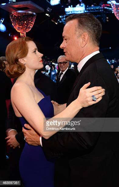 Actors Amy Adams and Tom Hanks attend the 20th Annual Screen Actors Guild Awards at The Shrine Auditorium on January 18 2014 in Los Angeles California