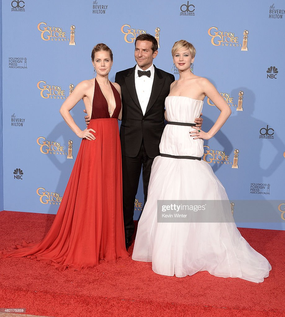 Actors Amy Adams Bradley Cooper and Jennifer Lawrence winners of Best Motion Picture Musical or Comedy for 'American Hustle' pose in the press room...