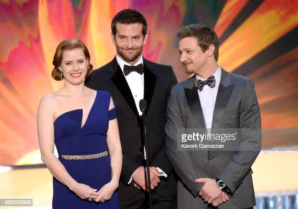 Actors Amy Adams Bradley Cooper and Jeremy Renner speak onstage during the 20th Annual Screen Actors Guild Awards at The Shrine Auditorium on January...