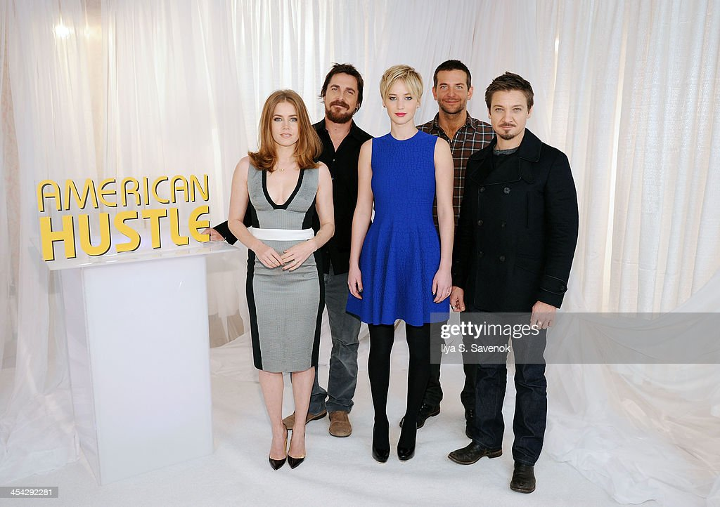 Actors Amy Adams, Christian Bale, Jennifer Lawrence, Bradley Cooper and Jeremy Renner attend 'American Hustle' Cast Photo Call at Crosby Street Hotel on December 8, 2013 in New York City.