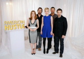 Actors Amy Adams Christian Bale Jennifer Lawrence Bradley Cooper and Jeremy Renner attend 'American Hustle' Cast Photo Call at Crosby Street Hotel on...