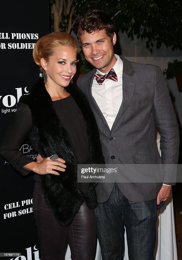 Actors Amy Paffrath (L) and Drew Seeley (R) attend the Cell Phones For Soldiers charity event sponsored by Voli Light Vodka at Sky Bar in the Mondrian Hotel on December 6, 2012 in West Hollywood, California.