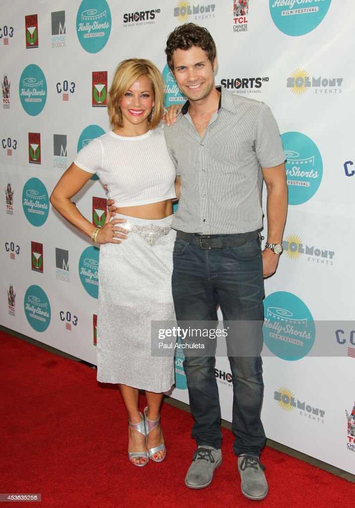 Actors Amy Paffrath (L) and Drew Seeley (R) attend the HollyShorts opening night gala at the TCL Chinese Theatre on August 14, 2014 in Hollywood, California.