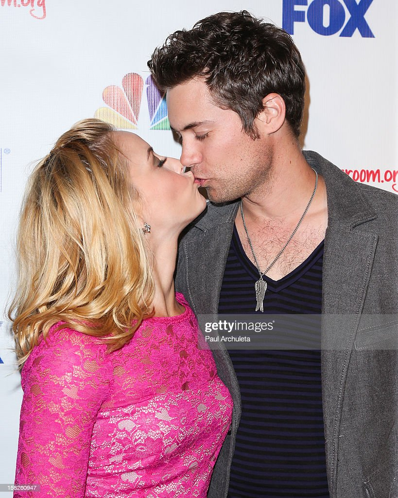 Actors Amy Paffrath (L) and Drew Seeley attend the Junior Hollywood Radio & Television Society's 10th annual holiday party at Boulevard3 on December 11, 2012 in Hollywood, California.