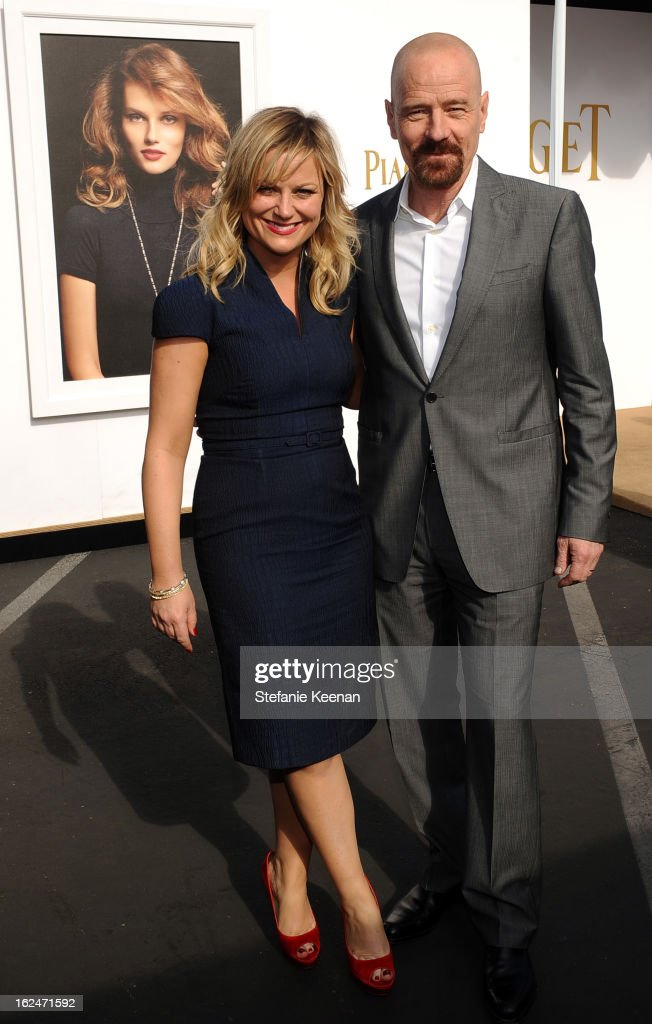 Actors Amy Poehler and Bryan Cranston pose in the Piaget Lounge during The 2013 Film Independent Spirit Awards on February 23, 2013 in Santa Monica, California.