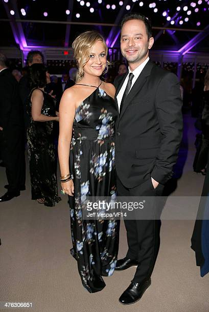 Actors Amy Poehler and Nick Kroll attend the 2014 Vanity Fair Oscar Party Hosted By Graydon Carter on March 2 2014 in West Hollywood California