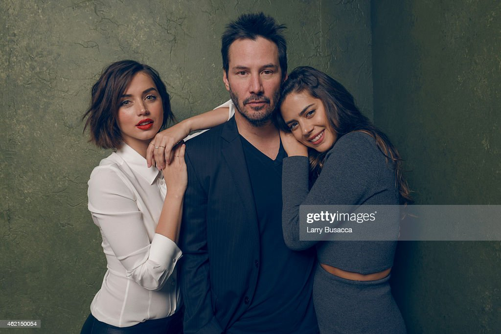 Actors Ana de Armas, Keanu Reeves and Lorenza Izzo from 'Knock Knock' pose for a portrait at the Village at the Lift Presented by McDonald's McCafe during the 2015 Sundance Film Festival on January 24, 2015 in Park City, Utah.