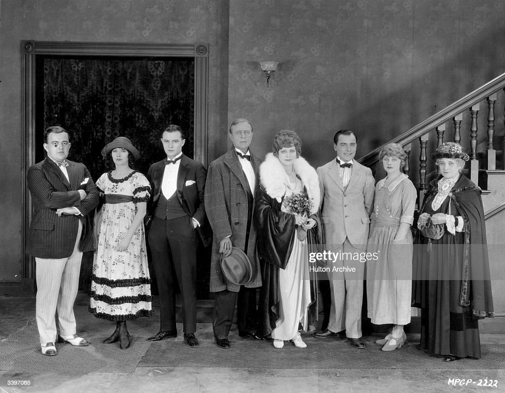 Actors and actresses from the cast of 'Bread', the MGM picture based on the novel by Charles G Norris. From left to right are: Victor Schertzinger (1880 - 1941) the American director, Mae Busch (1897 - 1946), Robert Frazer, Hobart Bosworth (1867 - 1943), Myrtle Stedman, Pat O'Malley (1891 - 1966), Wanda Hawley and Eugenie Besserer (1870 - 1934).