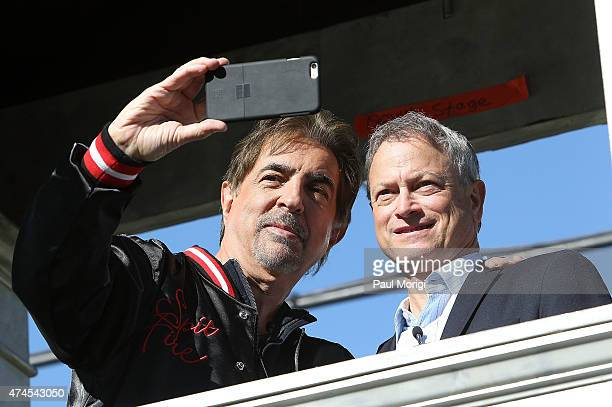 Actors and cohosts Joe Mantegna and Gary Sinise take a 'selfie' at the 26th National Memorial Day Concert Rehearsals on May 23 2015 in Washington DC