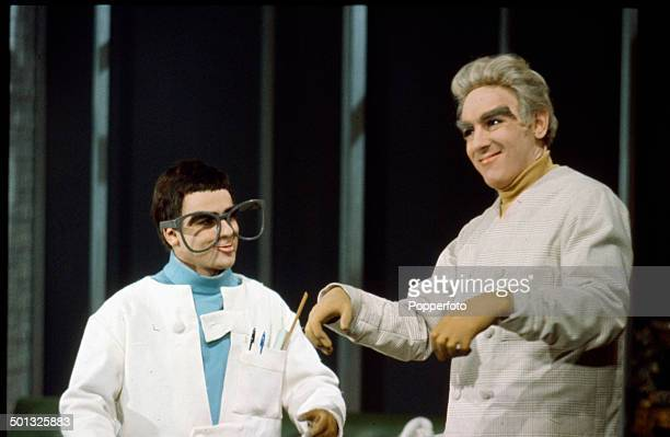 Actors and comedians Dudley Moore and Peter Cook pictured dressed as marionettes in a Thunderbirds style television sketch in 1966