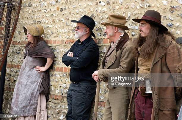 Actors and creator Terry Pratchett on the film set of the TV production of The Colour of Magic created by author Terry Pratchett at Pinewood Studios...
