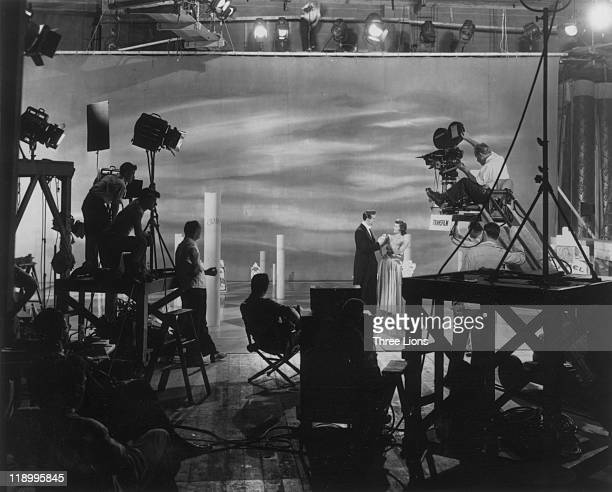Actors and crew take their positions on set as a television commercial for Camel cigarettes is filmed at Transfilm Inc in New York City New York USA...