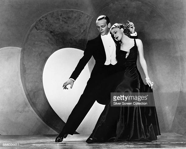 Actors and dancers Fred Astaire and Ginger Rogers in a publicity still for the film 'Roberta' in which they dance to the showtune 'Smoke Gets in Your...
