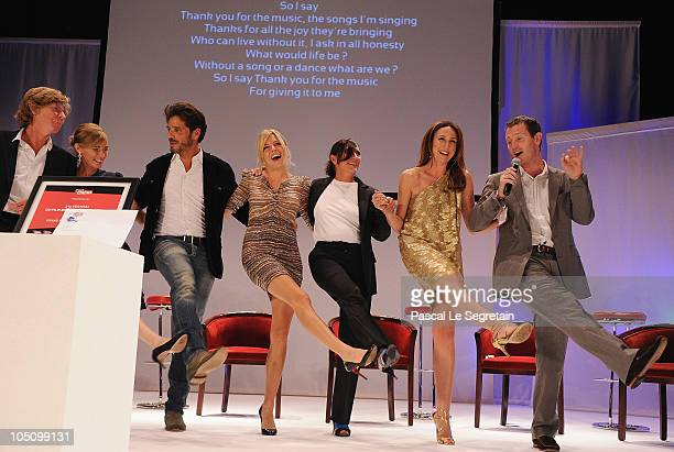Actors and jury members Etienne Chatillez Anne Consigny Pascal Elbe Sienna Miller Sylvie Pialat Elsa Zylberstein and Nick Moran dance on stage during...