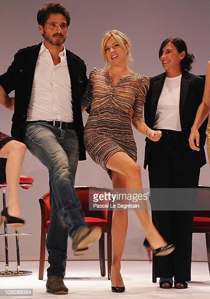 Actors and jury members Pascal Elbe Sienna Miller and Sylvie Pialat dance on stage during the award ceremony of the 21st Dinard British Film Festival...