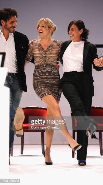 Actors and jury members Pascal Elbe Sienna Miller Sylvie Pialat dance on stage during the award ceremony of the 21st Dinard British Film Festival on...