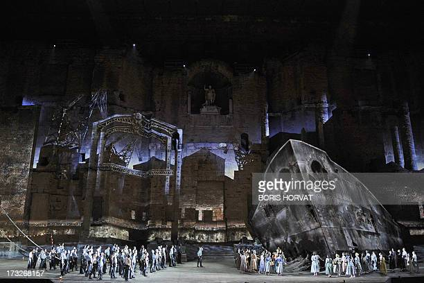 Actors and musicians perform during a rehearsal of German composer Richard Wagner's opera 'Der Fliegende Hollander' on July 10 2013 in the French...