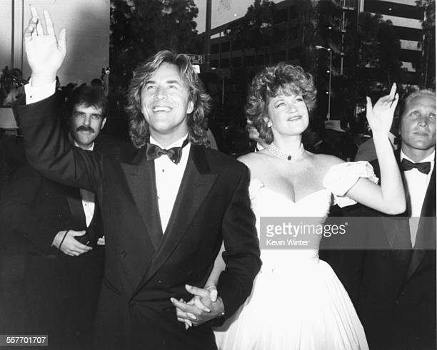 Actors and spouses Don Johnson and Melanie Griffiths waving as they arrive at the 61st Academy Awards at the Shrine Auditorium in Los Angeles March...