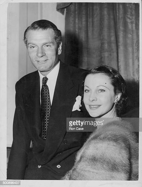 Actors and spouses Laurence Olivier and Vivien Leigh attending a party together following Vivien's recent illness July 16th 1953