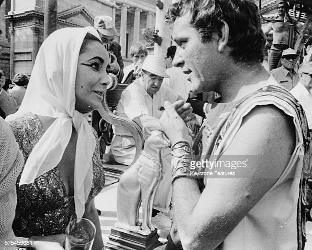 Actors and spouses Richard Burton and Elizabeth Taylor chatting on the set of the film 'Cleopatra' Rome May 1962
