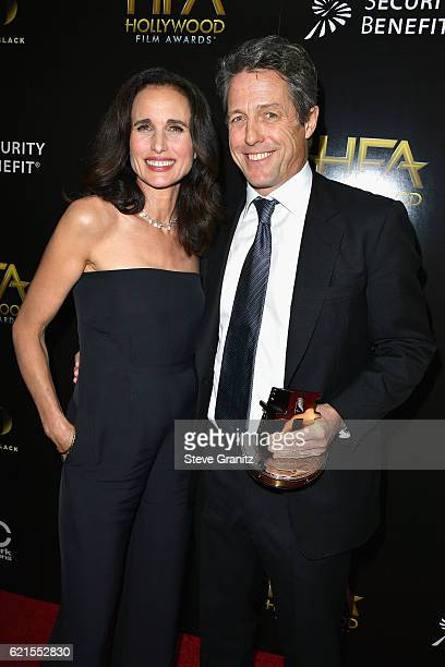 Actors Andie MacDowell and Hugh Grant recipient of the 'Hollywood Supporting Actor Award' for 'Florence Foster Jenkins' pose in the press room at the...
