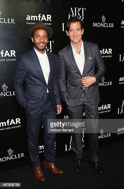 Actors André Holland and Clive Owen attend a private viewing and dinner for Art For Love 32 Photographers Interpret The Iconic Moncler Maya Jacket...