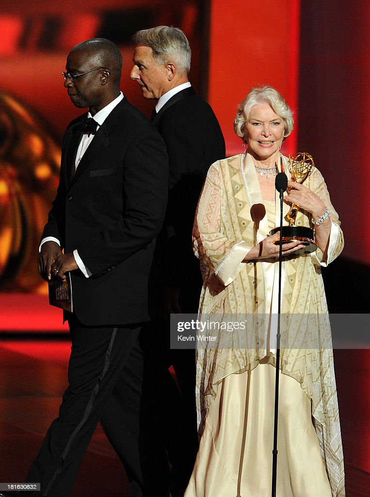 Actors Andre Braugher and Mark Harmon present the award for Outstanding Supporting Actress in a Miniseries or Movie to Ellen Burstyn onstage during the 65th Annual Primetime Emmy Awards held at Nokia Theatre L.A. Live on September 22, 2013 in Los Angeles, California.