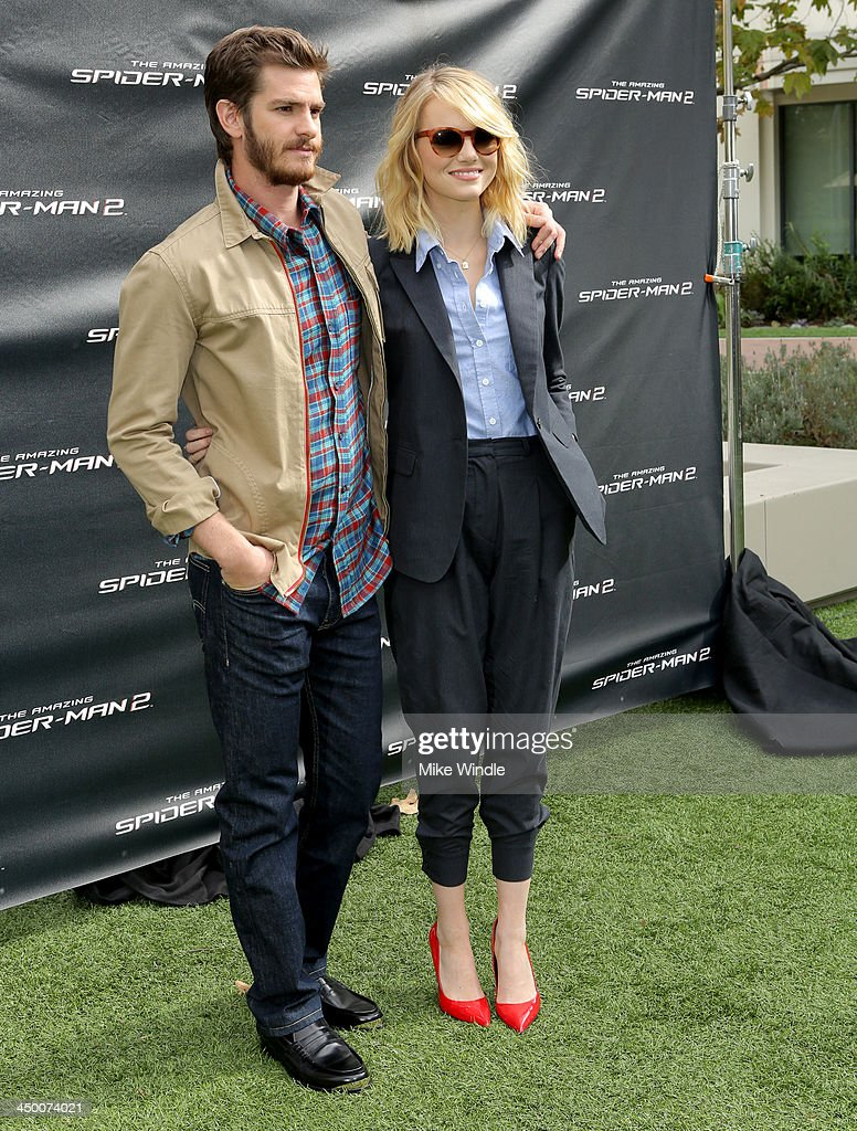 Actors Andrew Garfield and Emma Stone attend 'The Amazing Spiderman' fan event at Sony Pictures Studios on November 16, 2013 in Culver City, California.