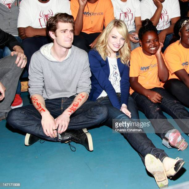 Actors Andrew Garfield and Emma Stone attend the 'Be Amazing' Stand Up Volunteer Initiative at Madison Boys And Girls Club on June 26 2012 in the...
